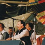 Nusrat Fateh Ali Kahn with Qawwali music group on the WOMAD stage