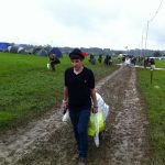Making our way into Glastonbury 2011 Wednesday morning, bit of rain and mud.